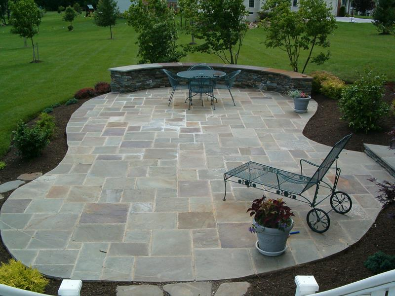 Adding stone patio designs to your backyards can give it a more relaxed and creative vibe. [Image Credit: Home Epiphany]